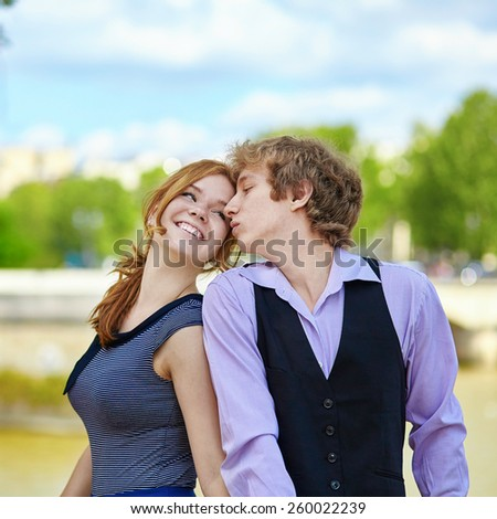 Dating couple enjoying warm sunny day in Paris - stock photo