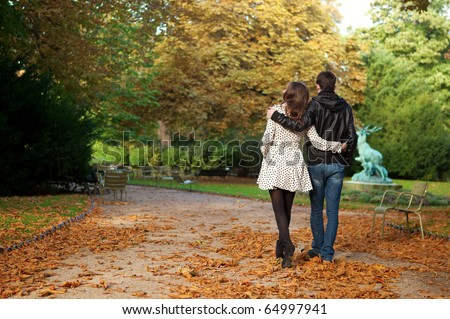 Dating couple in the Luxembourg garden of Paris - stock photo
