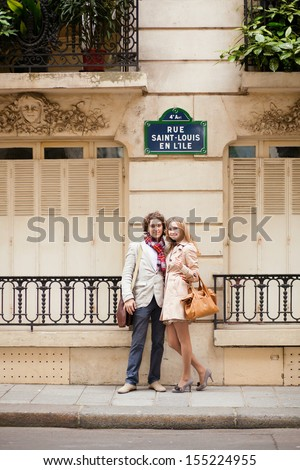 Dating couple on a Parisian street