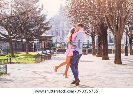 dating, happy young girl hugging her boyfriend - stock photo