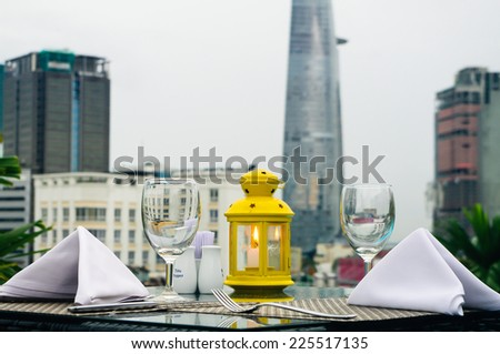 Dating on rooftop of Ho Chi Minh City, Vietnam - stock photo