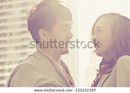 Dating young couple in love facing  - stock photo