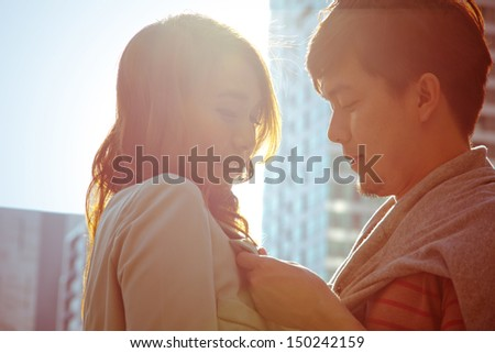 Dating young couple in love facing each other - stock photo