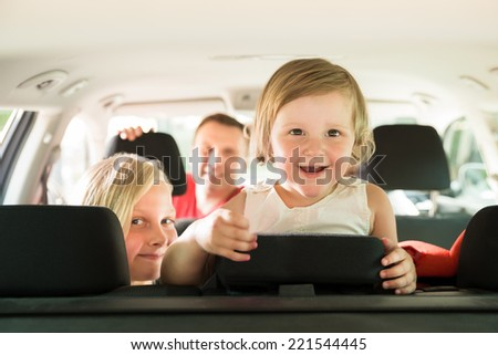 Daughter And Her Family Traveling By Car. Outdoors Shot - stock photo