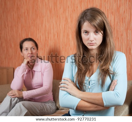 daughter and mature mother having quarrel at home - stock photo