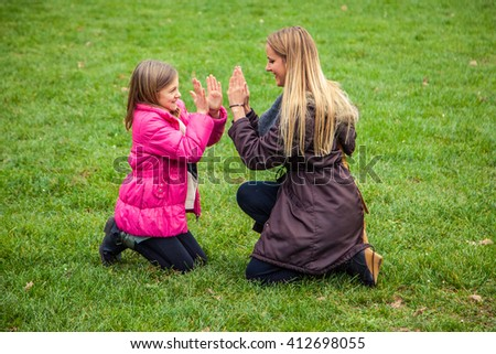 Daughter and mother bonding on an autumn day. - stock photo