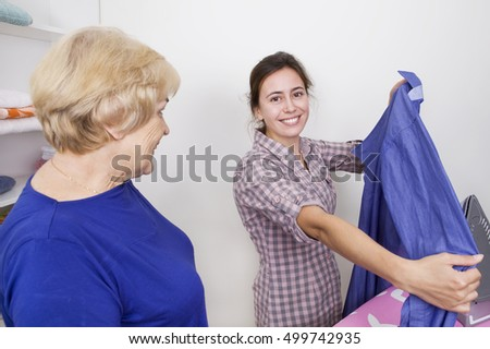 Daughter and mother during ironing