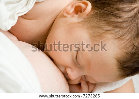 Daughter concentrating on breast milk. - stock photo