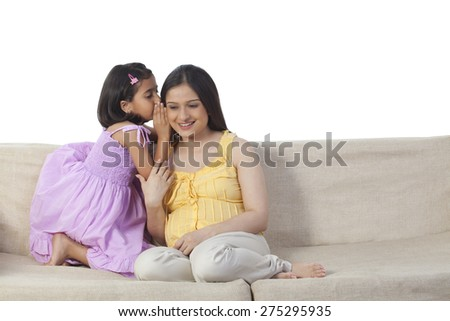 Daughter confiding in mother - stock photo