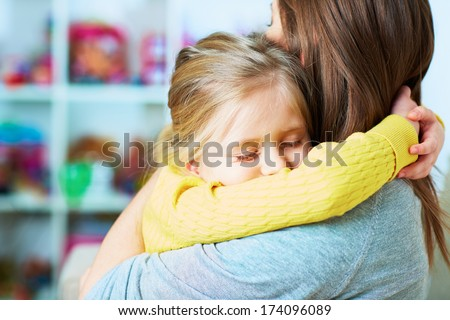 Daughter embrace mother. Sleep. Closed eyes. Home portrait. - stock photo