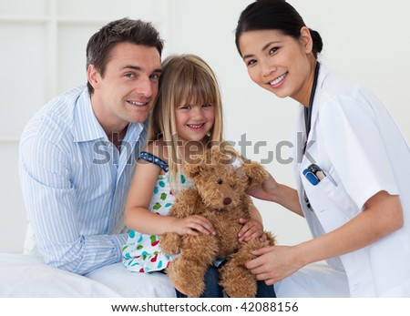 Daughter, father and doctor smiling at the camera - stock photo