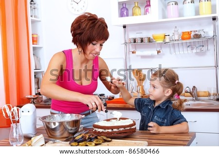 Daughter gives a little cream for her mother - stock photo