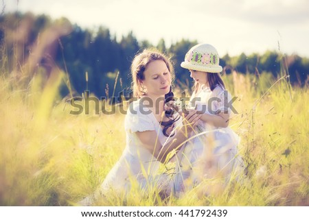 Daughter gives mother flowers. - stock photo