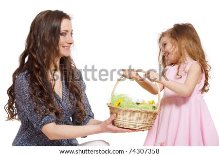 Daughter giving Easter basket to her mom - stock photo