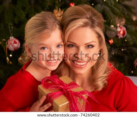 Daughter Giving Mother Christmas Gift - stock photo