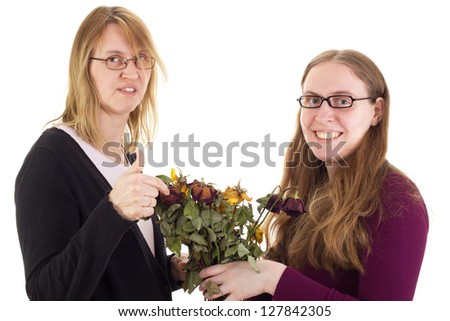 Daughter giving mother dried roses - stock photo