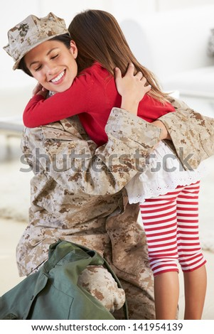 Daughter Greeting Military Mother Home On Leave - stock photo