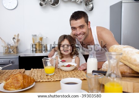 Daughter having breakfast with her father in kitchen