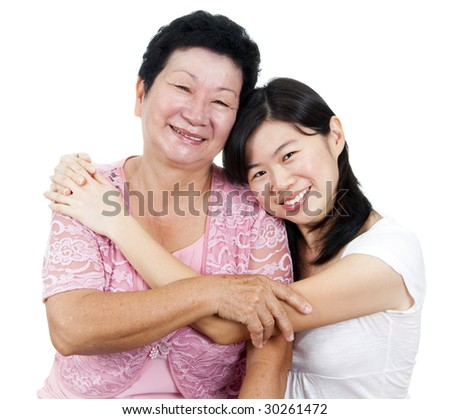 Daughter hugging her mother. - stock photo