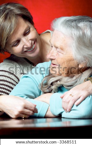 Daughter hugging her mother. Focus on the younger woman.