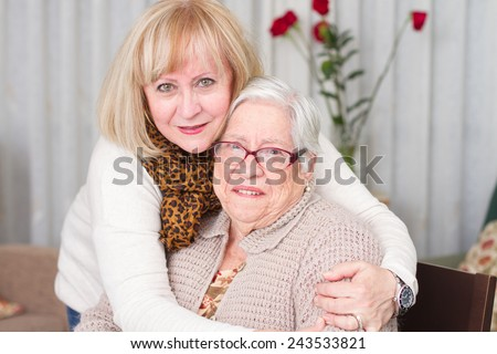 Daughter hugging her mother with affection