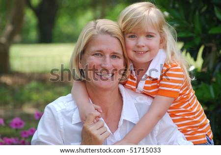 daughter hugging mom - stock photo