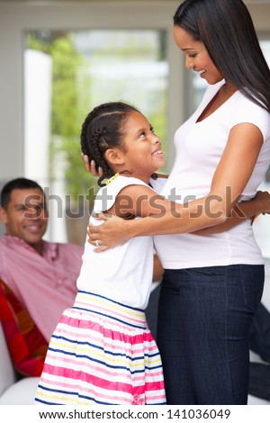 Daughter Hugging Pregnant Mother - stock photo