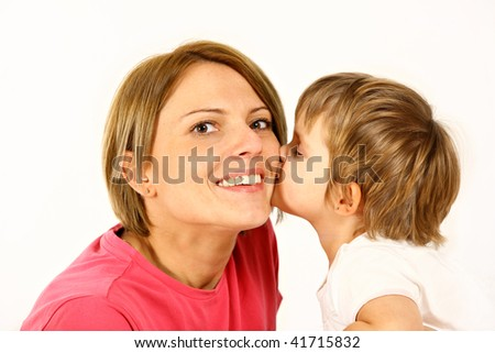 daughter is kissing her mother over white background