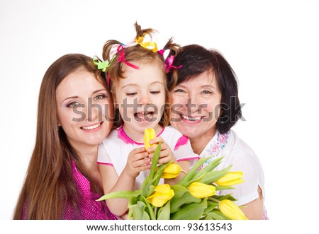 Daughter, mother and grandmother embracing - stock photo