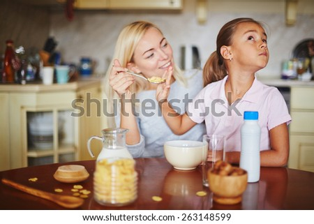 Daughter refusing from food - stock photo