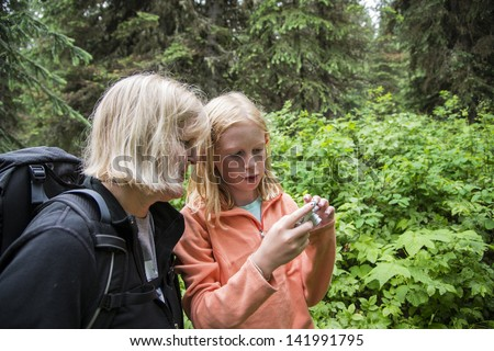 Daughter showing her mother photos on a camera