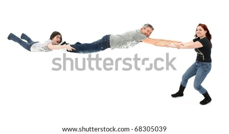 Daughter spinning father and sister around over white background. New spin metaphor concept.  Middle aged new spin on life concept. - stock photo