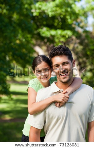 Daughter with her father in the park - stock photo