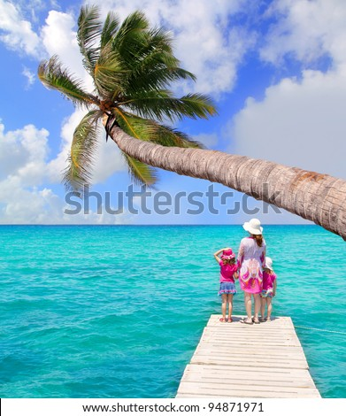 Daughters and mother in jetty on Formentera with turquoise sea [photo illustration] - stock photo