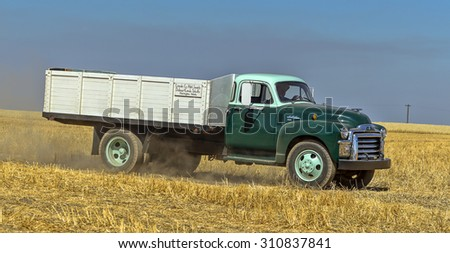 Davenport, WA. USA - Aug 22, 2015. A panorama of a vintage farm truck in the field near Davenport, Washington during the vintage harvest. - stock photo