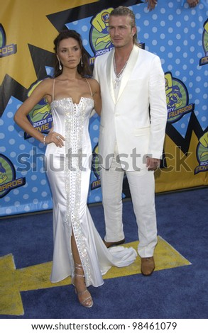 DAVID BECKHAM & VICTORIA POSH SPICE BECKHAM at the 2003 MTV Movie Awards in Los Angeles. May 31, 2003 - stock photo