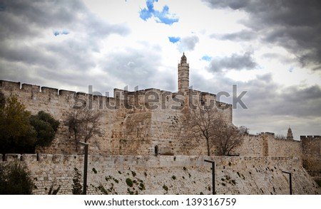 David tower in jerusalem stone boundary wall with cloudy sky - stock photo