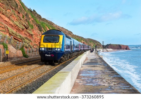 DAWLISH, DEVON, UK - 30 JAN 2016: First Great Western HST 125 train travelling on the South Devon Line near Dawlish. This line is often affected by winter storms. - stock photo