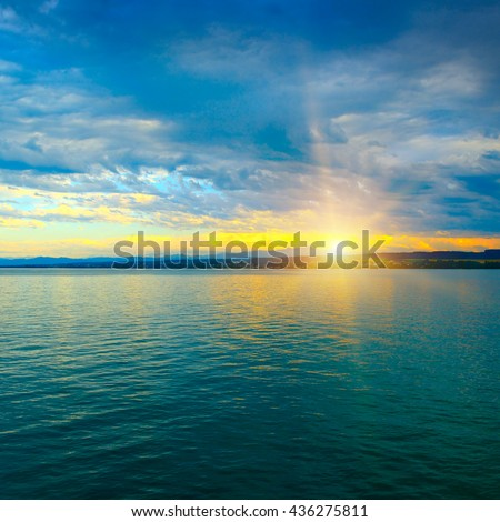 Dawn above sea and blue sky - stock photo