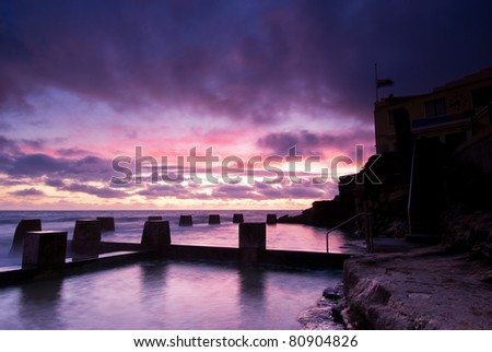 Dawn at a tidal pool in Coogee - a famous beach in eastern Sydney (it is near Bondi) - stock photo