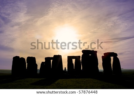 Dawn at Stonehenge a world heritage site in England UK - stock photo