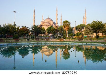 Dawn at the Blue Mosque (Sultan Ahmet Camii) with reflection on water in tranquil scenery of Sultanahmet district in Istanbul, Turkey - stock photo