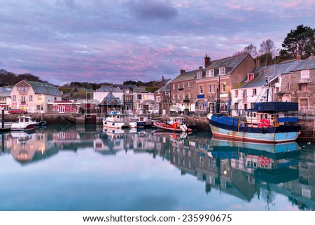 Dawn at the harbour in Padstow an historic fishing town on the north Cornwall coast - stock photo