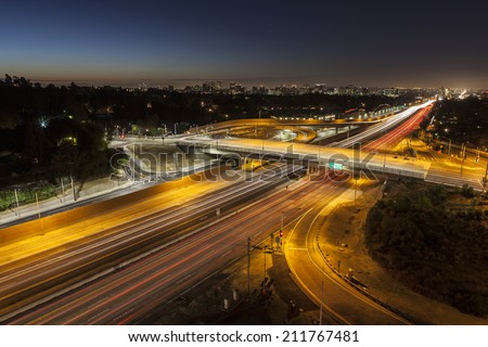 Dawn glow above the San Diego 405 Freeway at Sunset Blvd in Los Angeles, California. - stock photo