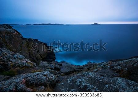 Dawn in Swedish east coast archipelago. Long exposure - stock photo