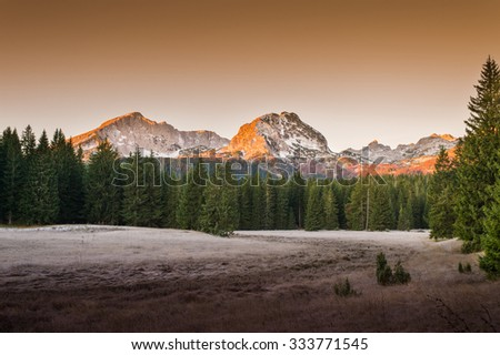 Dawn landscape with a view on the mountain peaks in National Park Durmitor - Montenegro - stock photo