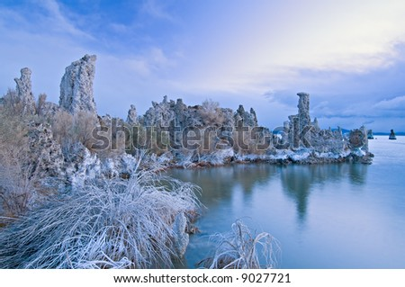 Dawn, Mono Lake with tufa formations and reflections in calm water,  California, USA - stock photo
