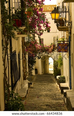 Dawn. Narrow street in a small Mediterranean village. Cadaques, Costa Brava, Catalonia, Spain - stock photo