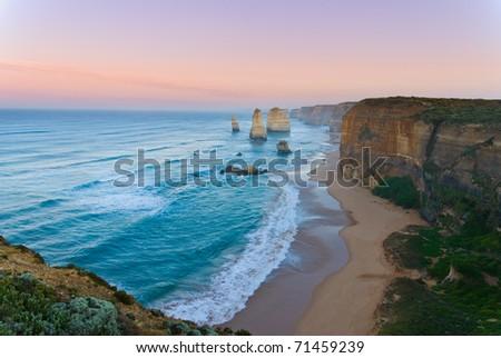 Dawn on the landmark Twelve Apostles along the Great Ocean Road in Victoria, Australia - stock photo