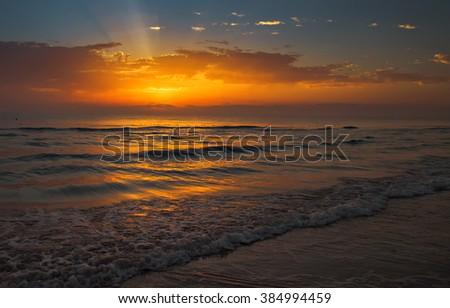 Dawn on the Mediterranean Sea, orange sunset - stock photo